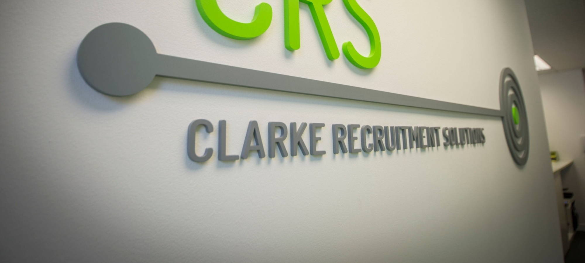 Clarke Recruitment logo placed on our office wall
